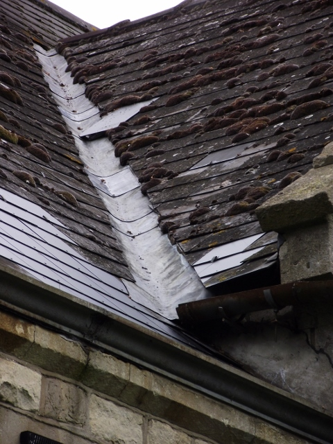 Mismatched and unsecured roof slates